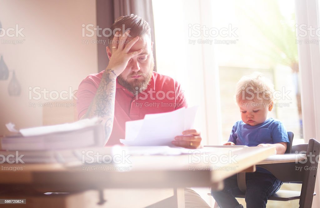 Struggling with debt stock photo