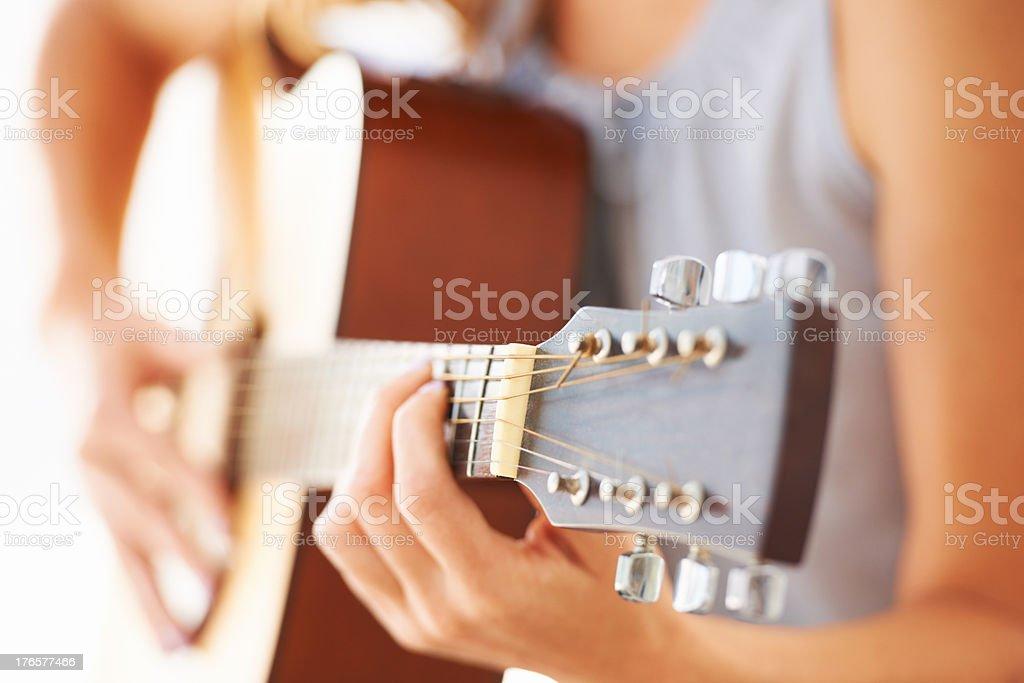 Strumming a melody stock photo