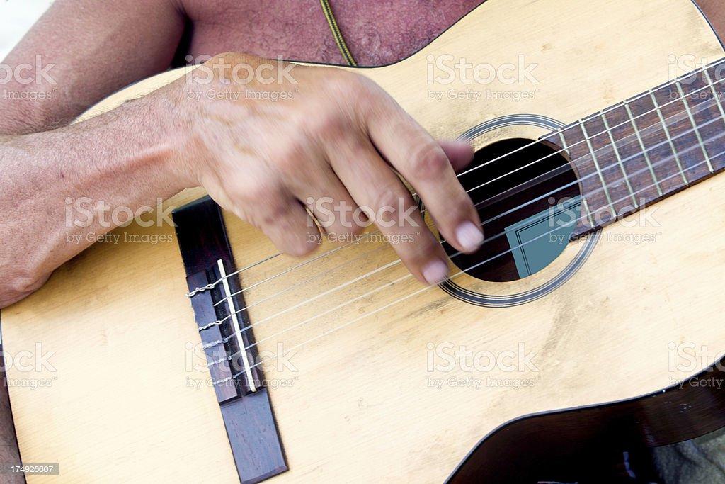Strumming guitar royalty-free stock photo
