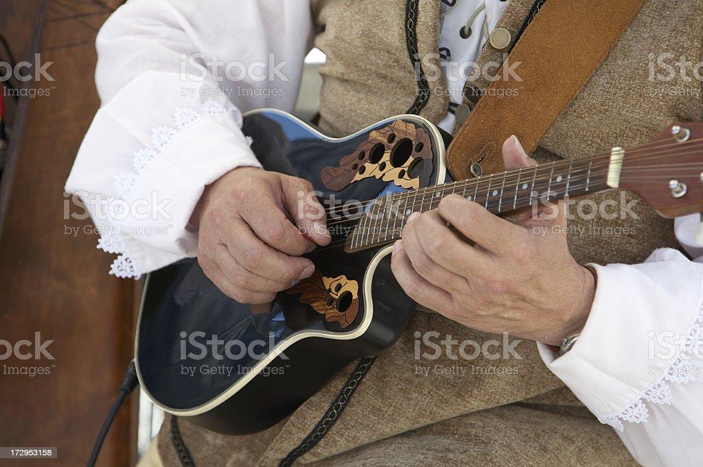 Strumming minstrel stock photo