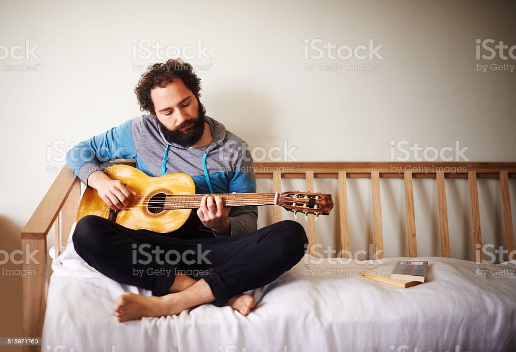 Strumming the chords stock photo