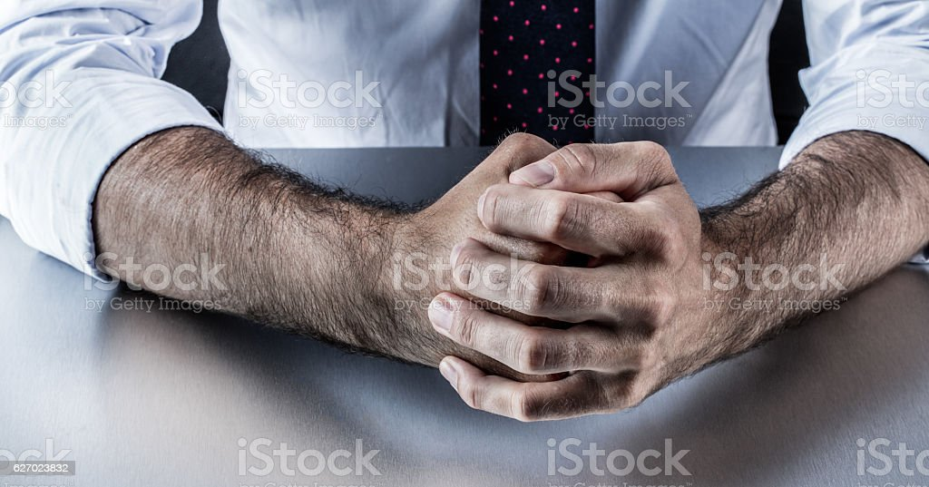 stubborn businessman fists for fighting body language in corporate business stock photo