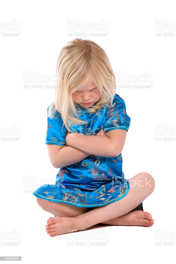 Stubborn little girl with arms crossed royalty-free stock photo