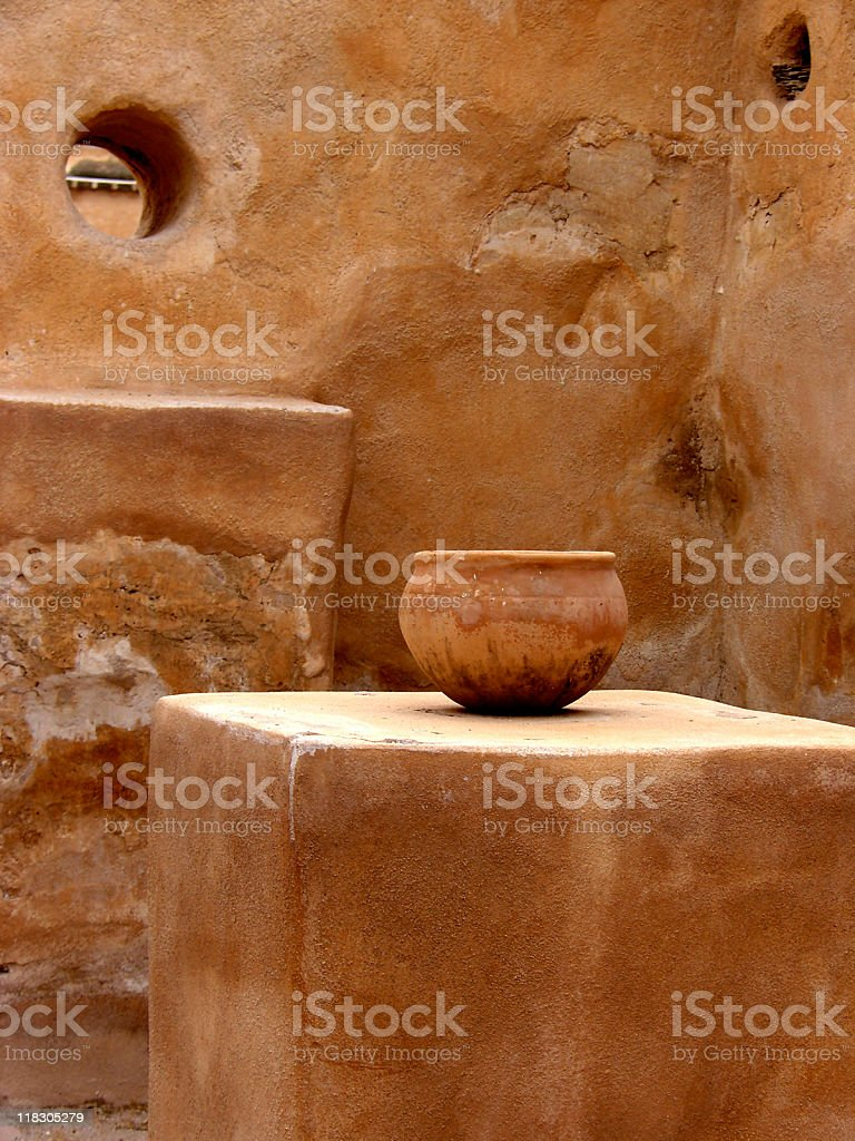Stucco building with clay bowl on stone pedestal Tumacacori Mission stock photo