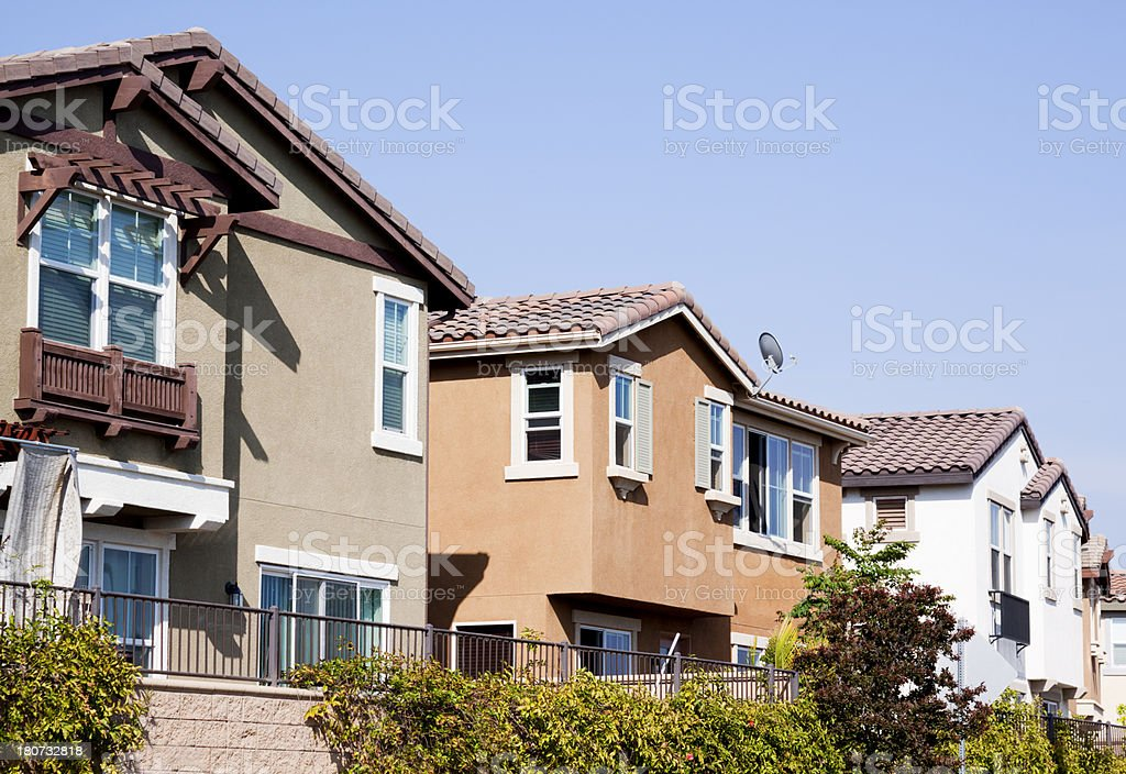 Stucco Home Exterior and Blue Sky royalty-free stock photo