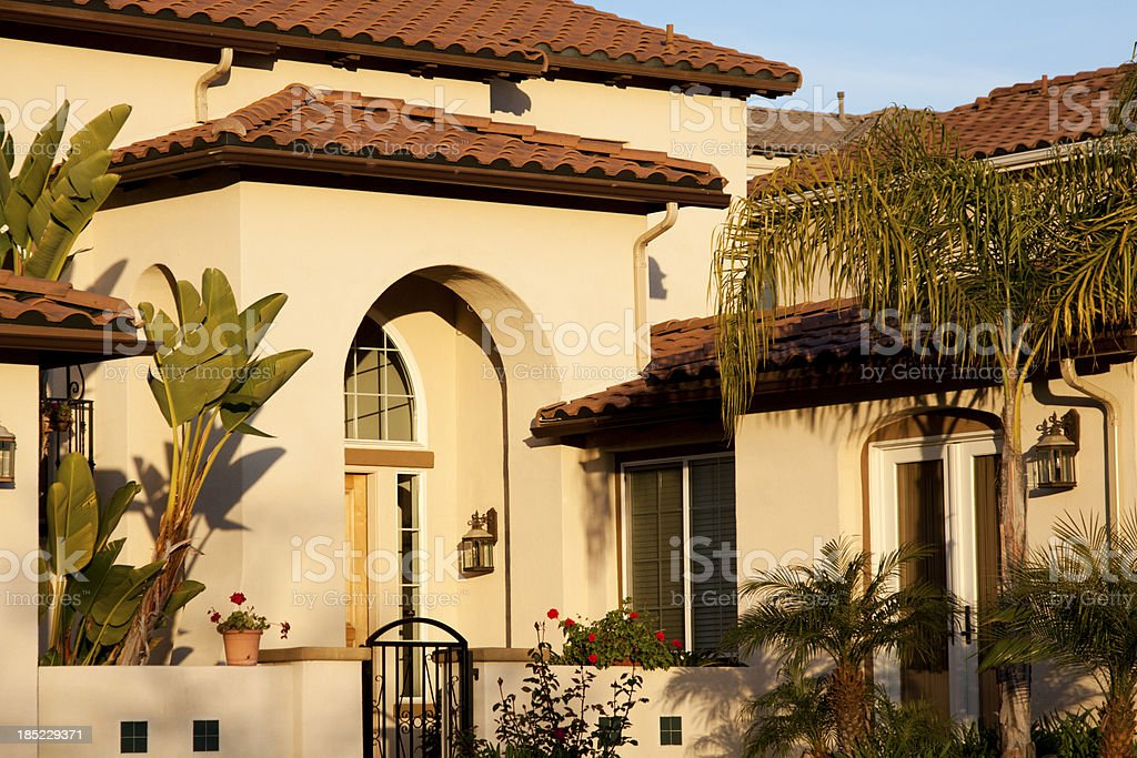 Stucco Home Exterior with Arched Entry stock photo