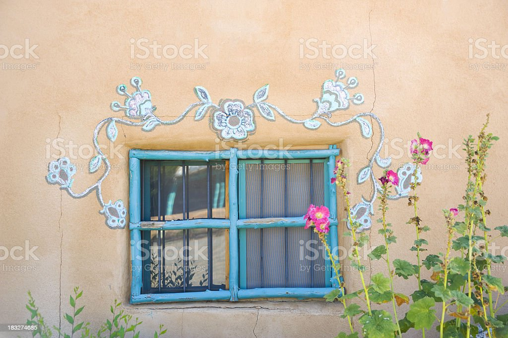 Stucco Window and Hollyhocks royalty-free stock photo