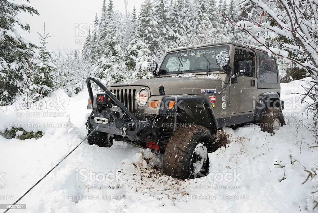 Stuck Jeep Winches Out royalty-free stock photo
