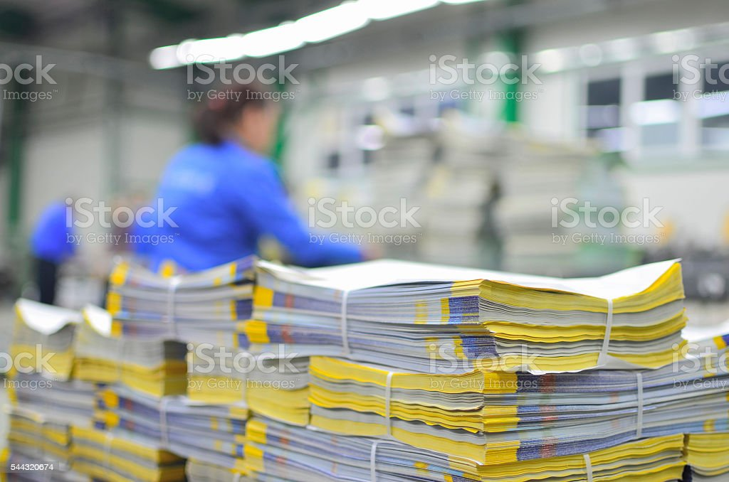 stuck of newspaper magazine in print production process stock photo