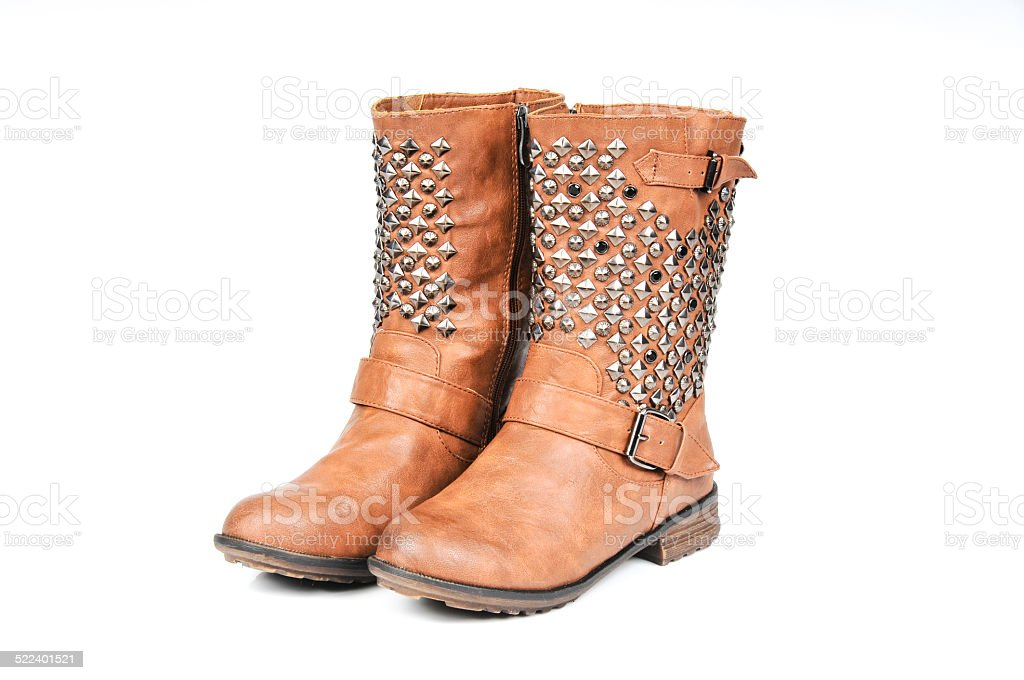 Studded Buckle-Strap Brown Boots. Angle view stock photo