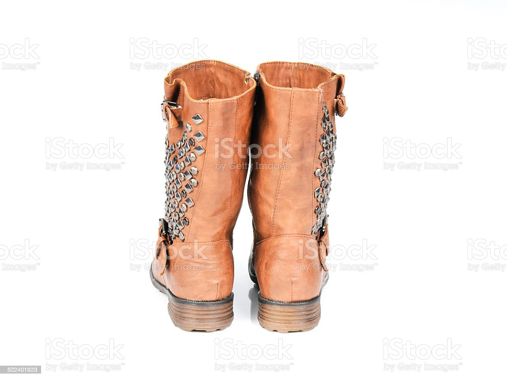 Studded Buckle-Strap Brown Boots. Back view stock photo