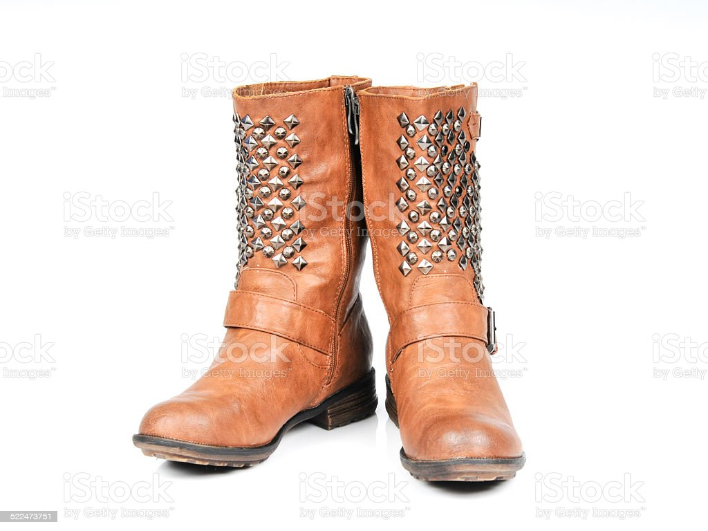 Studded Buckle-Strap Brown Boots. Front view stock photo