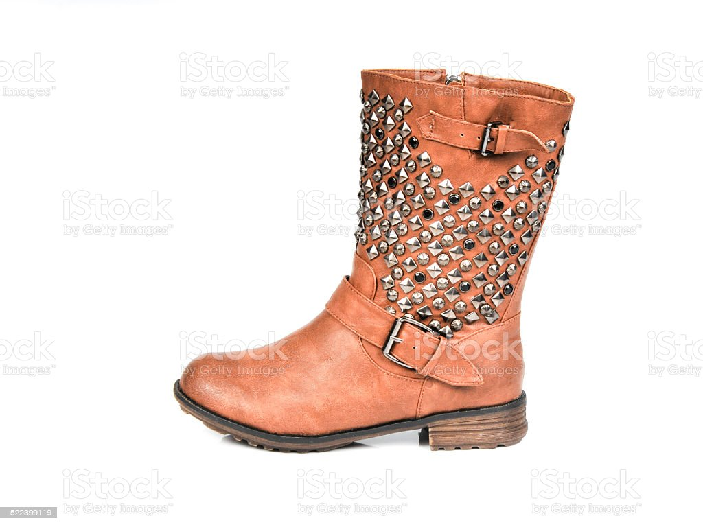Studded Buckle-Strap Brown Boots. Profile view stock photo
