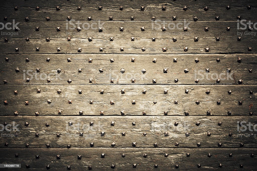 Studded Wooden Wall stock photo