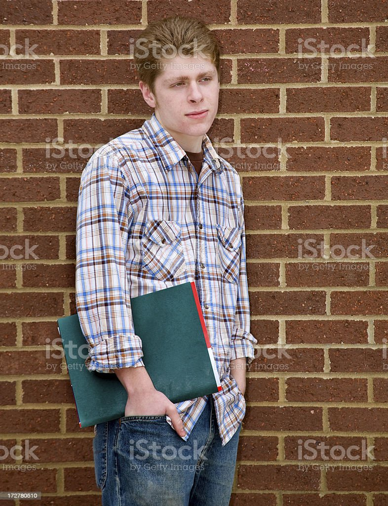 student against brick wall royalty-free stock photo