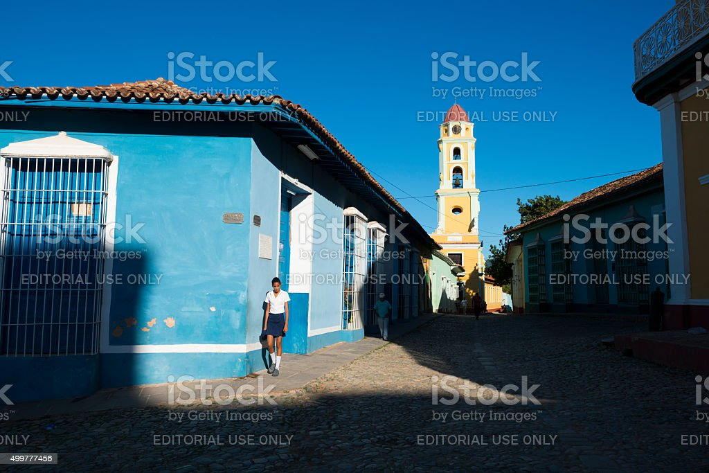 Student and sunlight in Trinidad, Cuba stock photo