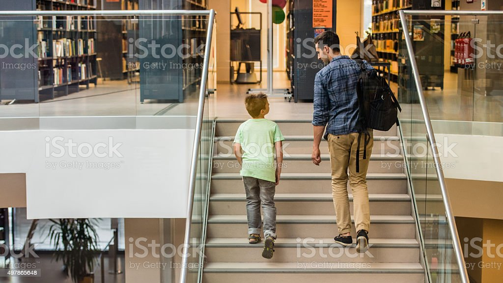 Student and teacher in library stock photo