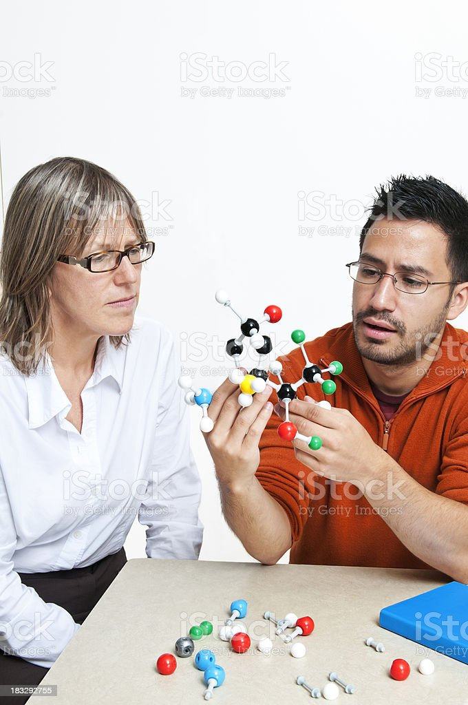 Student and teacher working with chemistry models (isolated) - III royalty-free stock photo