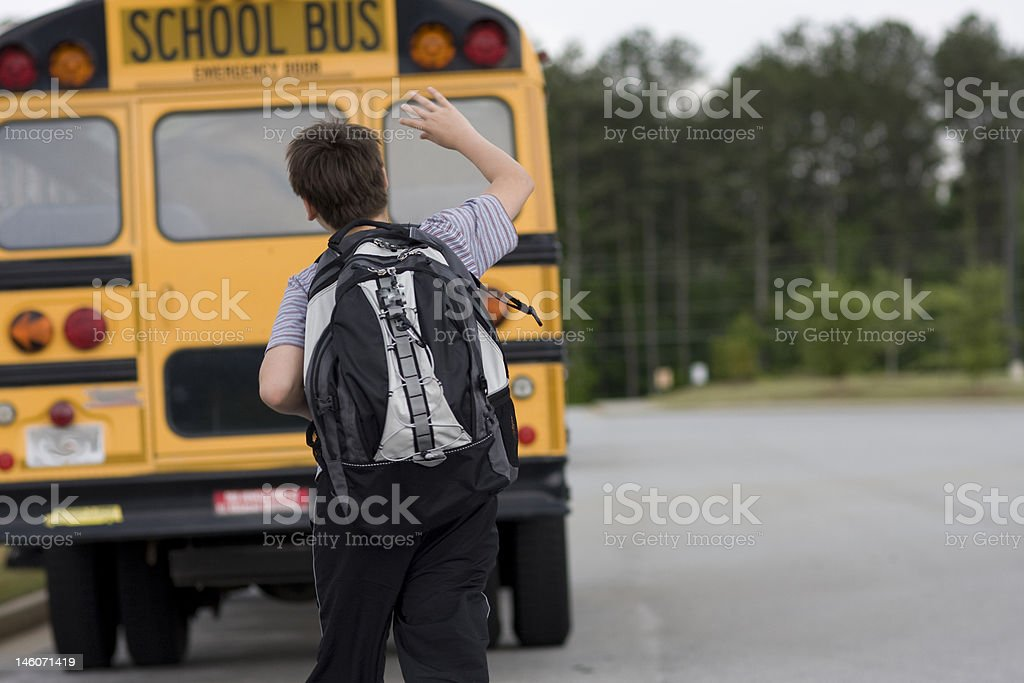 Student and the school bus stock photo