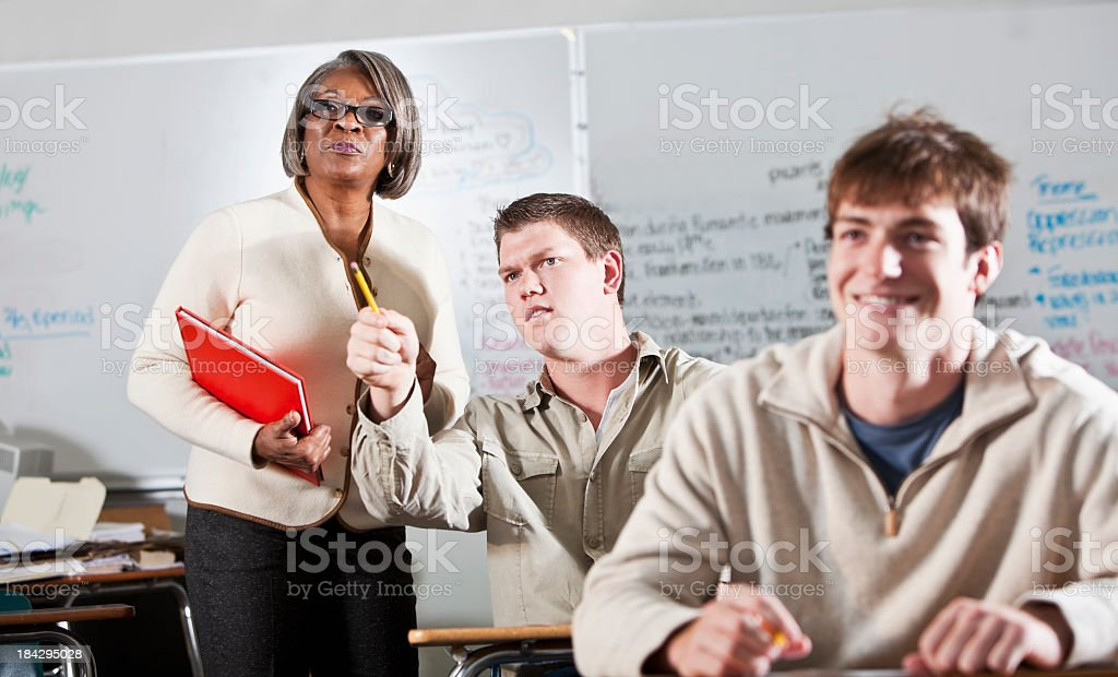 Student asking teacher question royalty-free stock photo