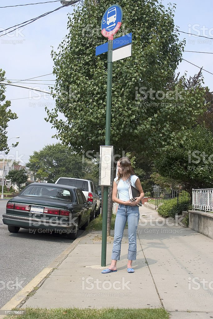 Student at a bus stop royalty-free stock photo