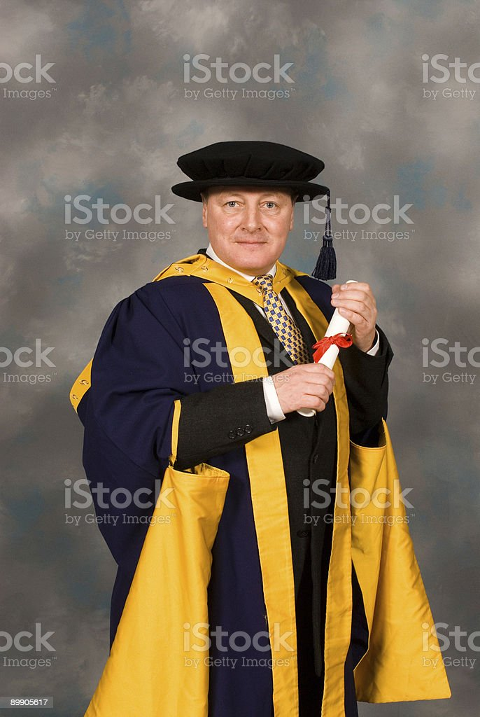 PHD student at graduation ceremony in full robes stock photo