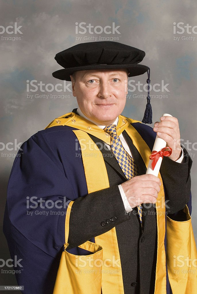 PHD student at his graduation ceremony in full robes royalty-free stock photo
