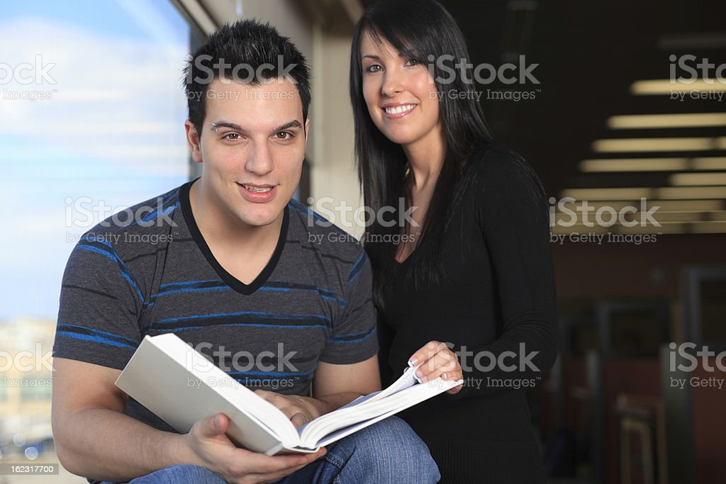 Student at Library - Smiling on the Edge of Window royalty-free stock photo