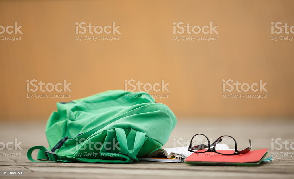 Student backpack with notebooks and points blurred background stock photo