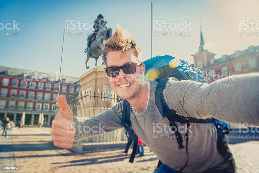 student backpacker tourist taking selfie photo with stick and mobile stock photo