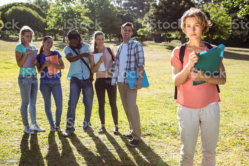 Student being bullied by a group of students stock photo
