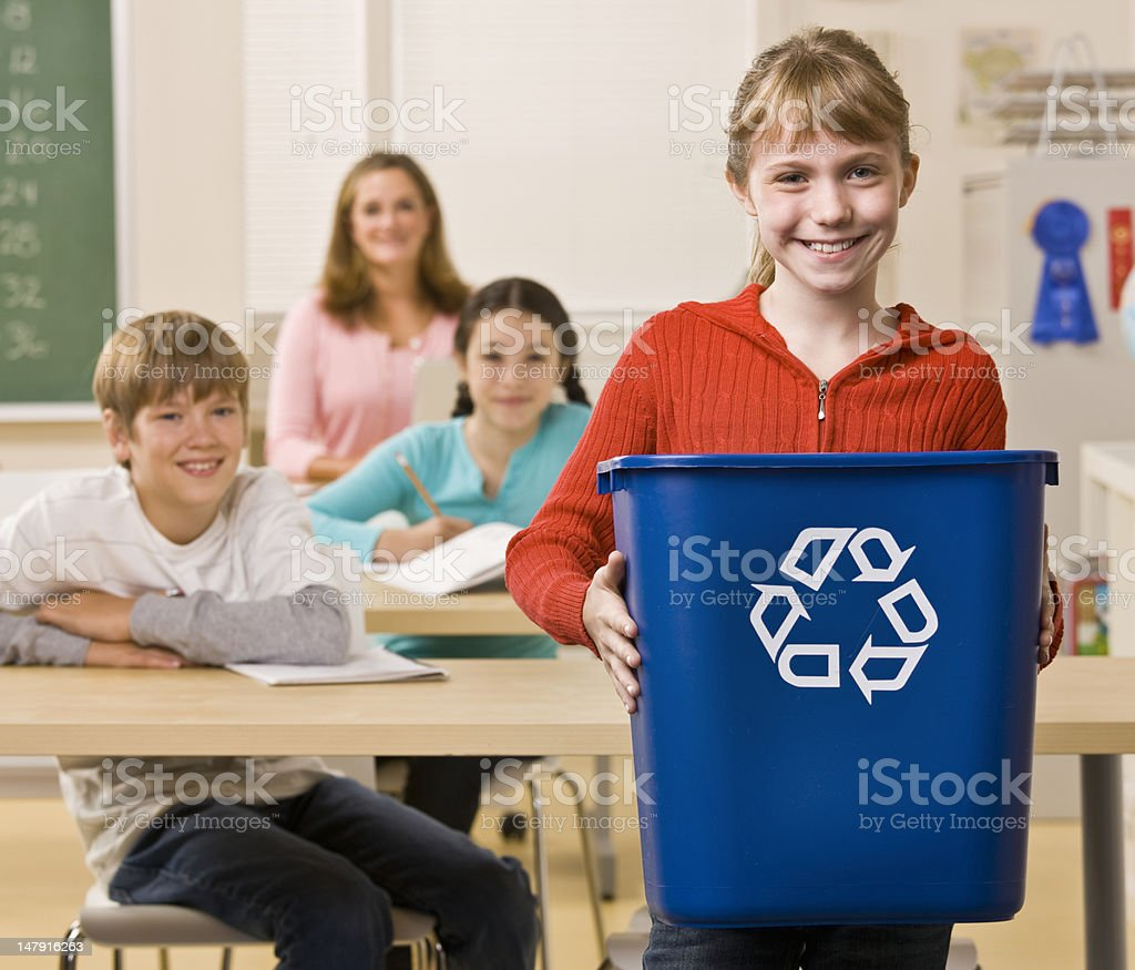 Student Carrying a Recycling Bin royalty-free stock photo