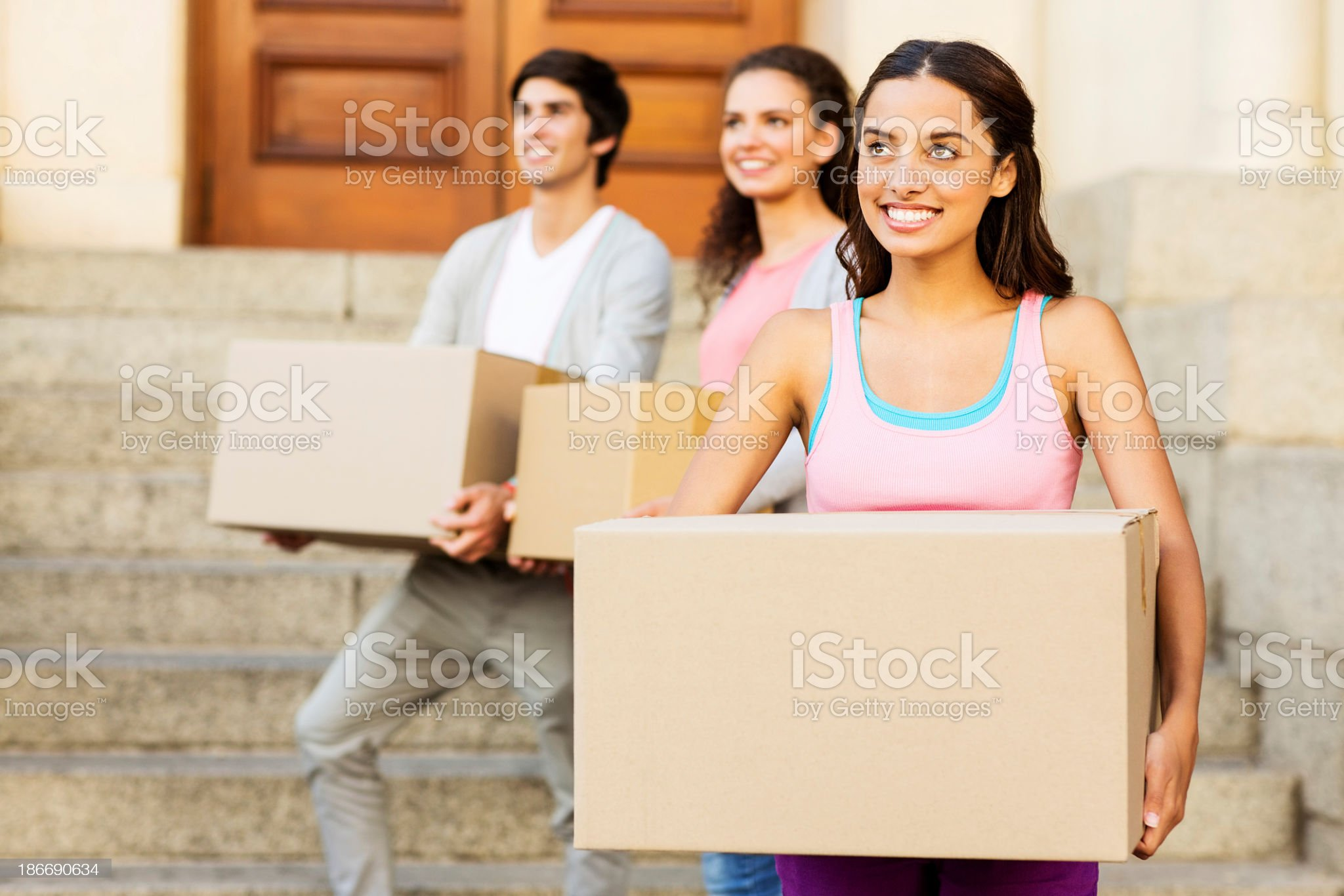 Student Carrying Cardboard Box While Looking Away royalty-free stock photo