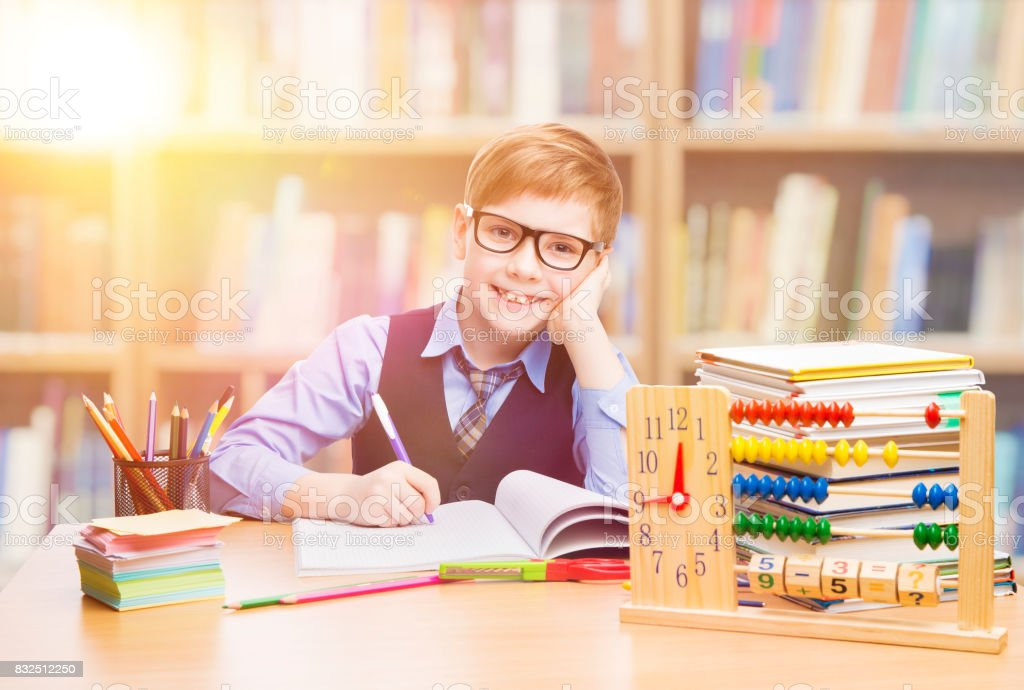 Student Child in School, Kid Boy Learning Mathematics in Classroom, Education stock photo