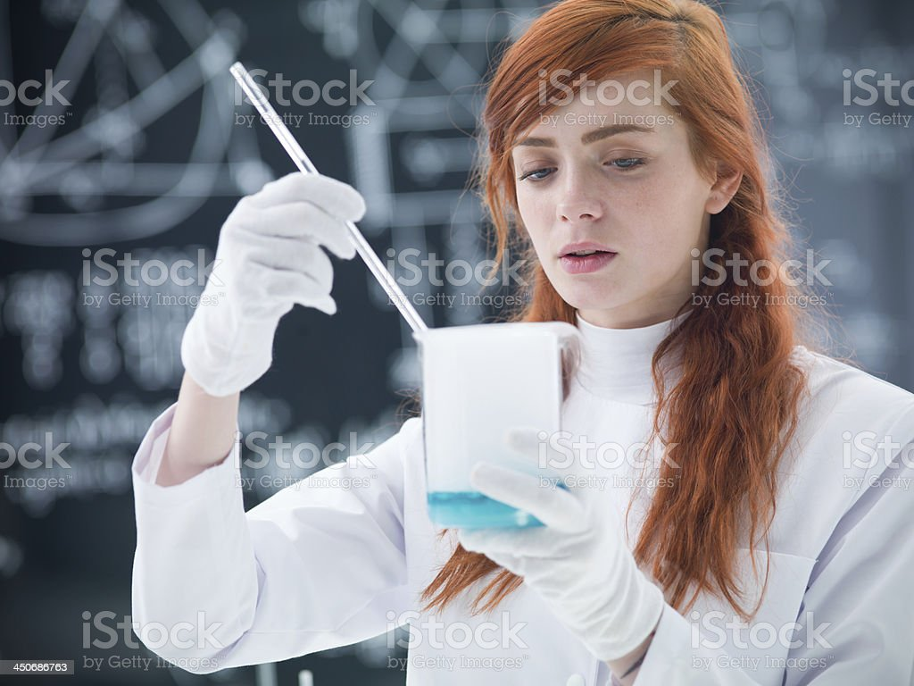 student conducting experiment royalty-free stock photo