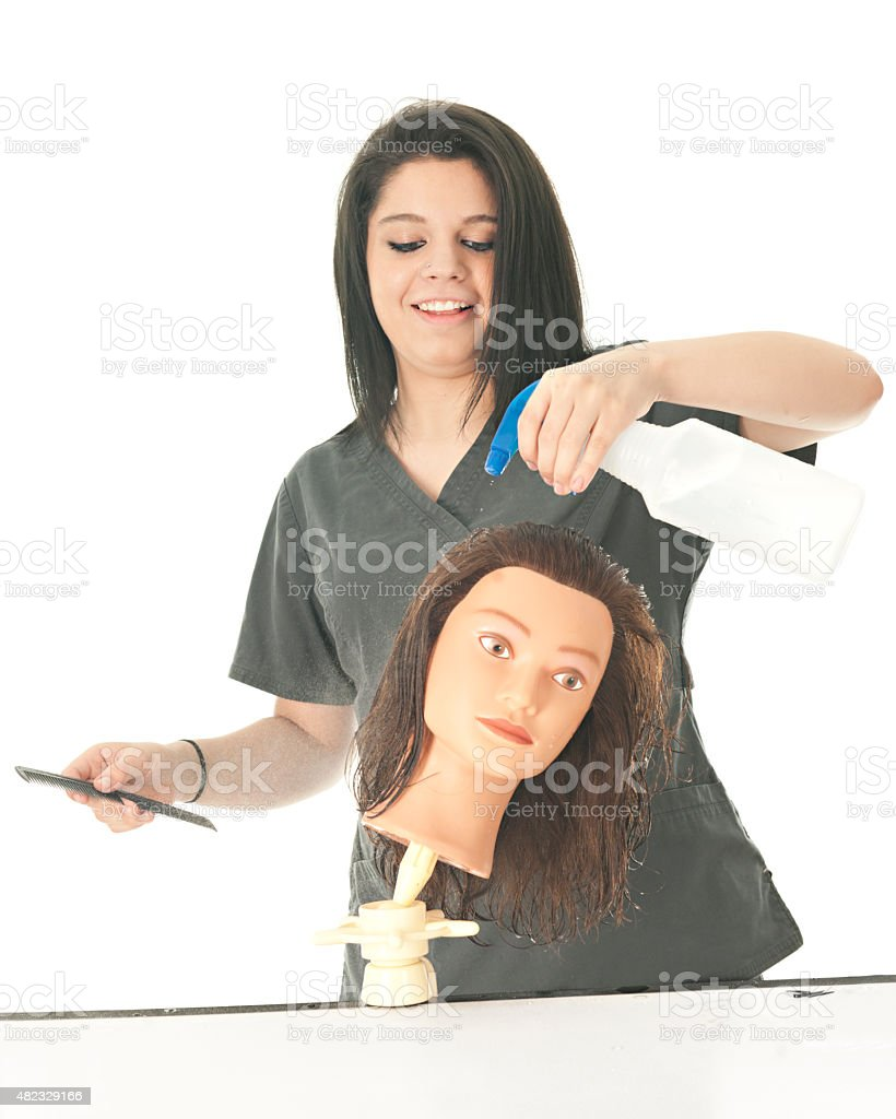 Student Cosmetologist Spraying the Head stock photo