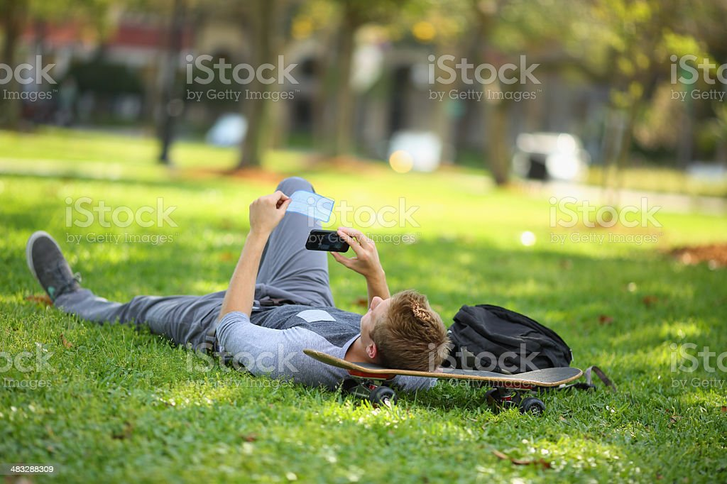 Student depositing check with mobile phone stock photo