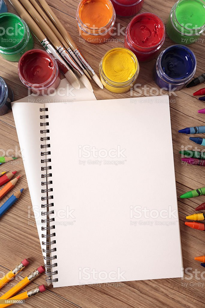 Student desk with folded book and school supplies stock photo