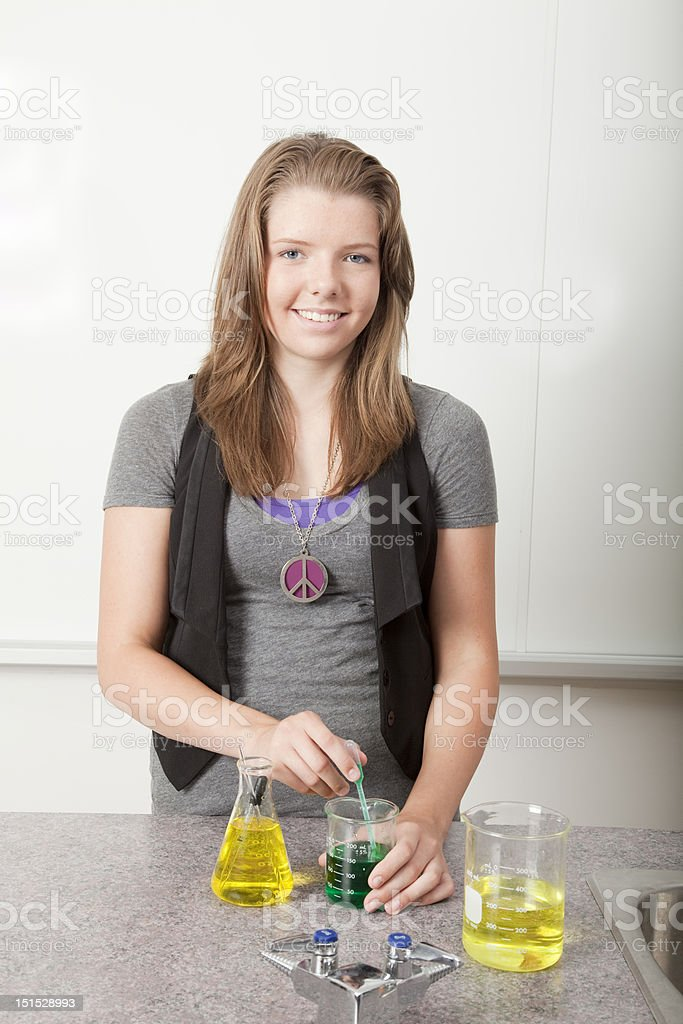 Student doing chemistry experiment stock photo