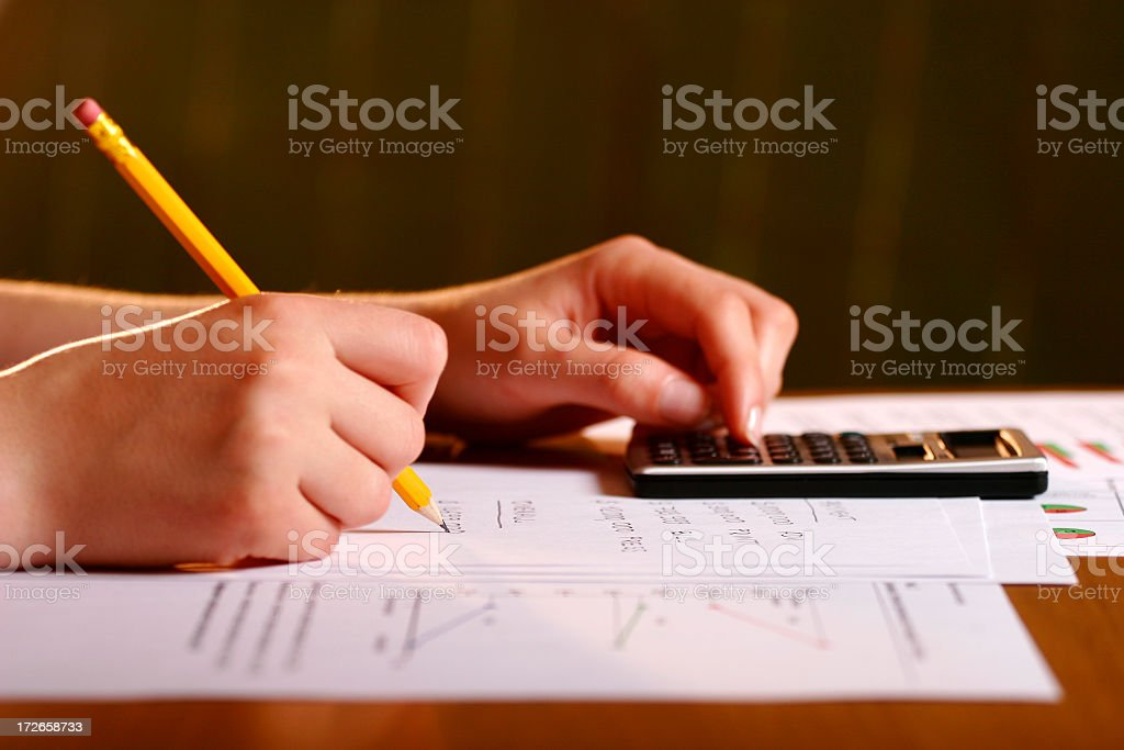 A student doing their math homework in pencil  stock photo