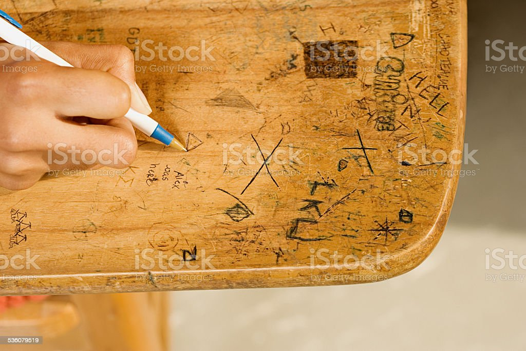 Student drawing on desk stock photo