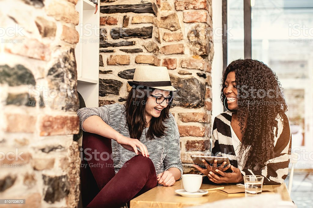 Student friends debating at the coffee shop stock photo