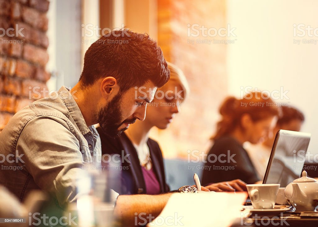 Student friends studying at cafe stock photo