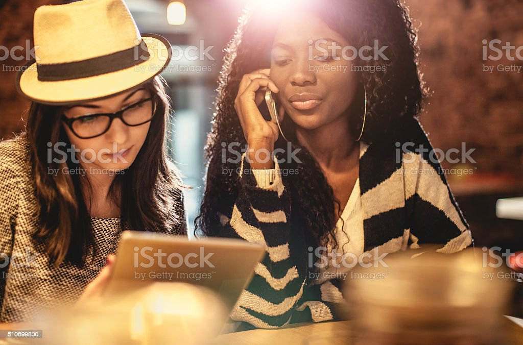 Student friends studying at coffee shop stock photo