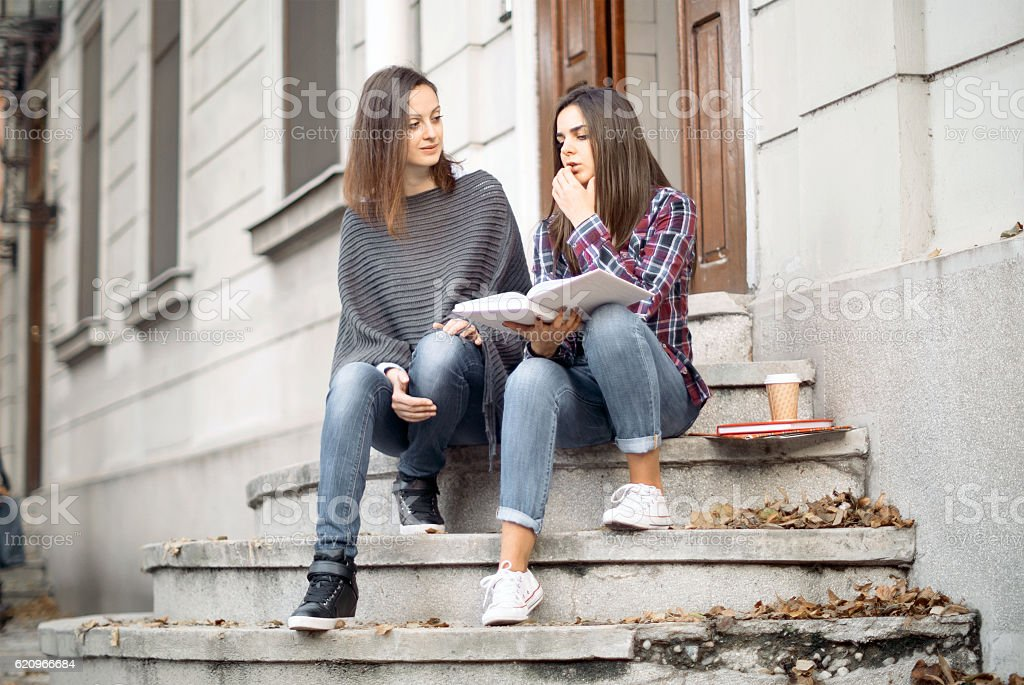 Student getting help from tutor at the university stock photo