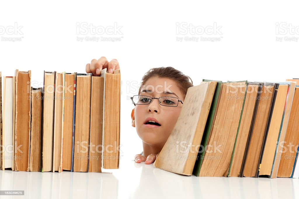 Student girl found a book that sought. royalty-free stock photo