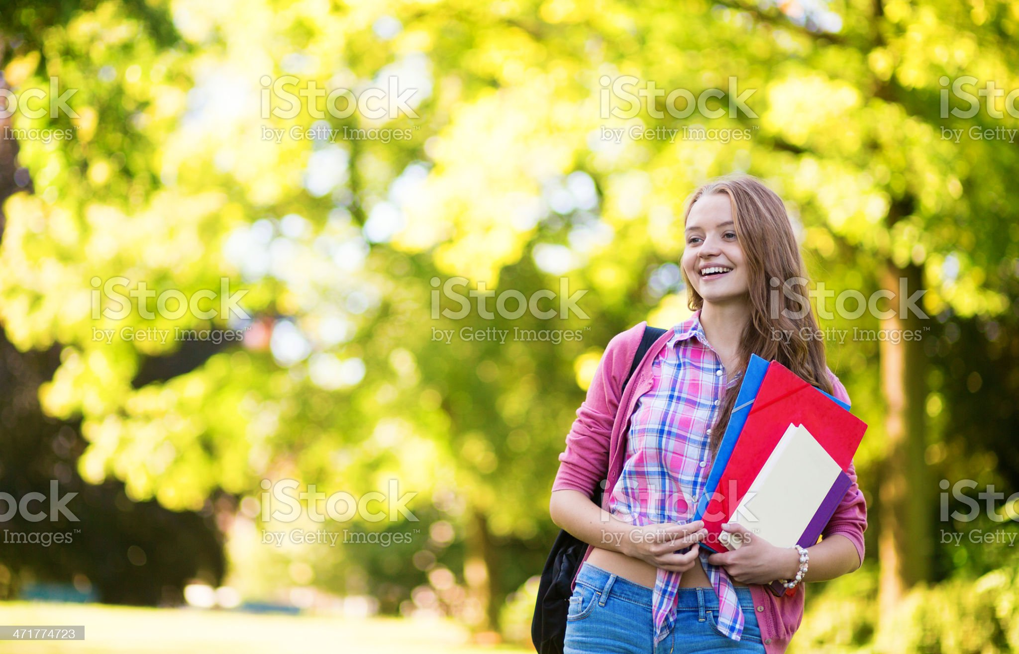 Student girl going back to school and smiling royalty-free stock photo