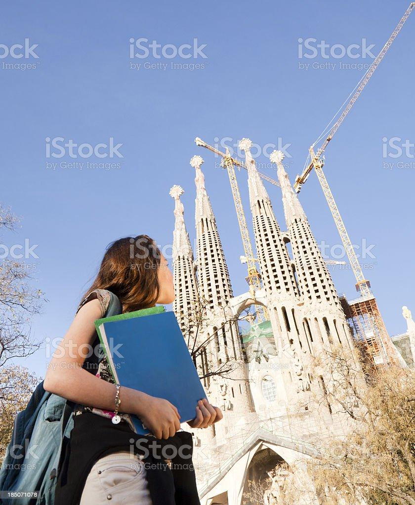 Student girl next to Sagrada Familia royalty-free stock photo