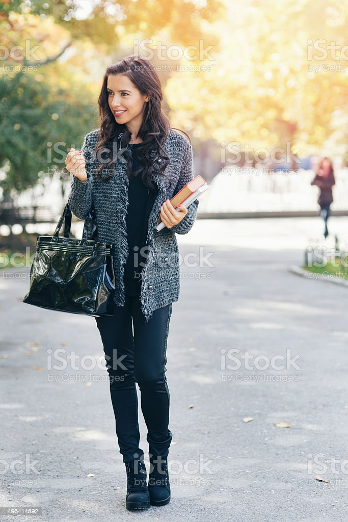 Student girl walking in the park stock photo