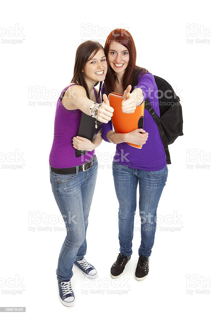 Student girlfriends gesturing thumbs up sign royalty-free stock photo